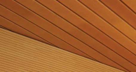 Revestimiento Natura: Revestimiento enchapado con madera natural, puede ser perforado o ranurado, cuenta con propiedades de  absorción acústica, además de ser resistente a la humedad.